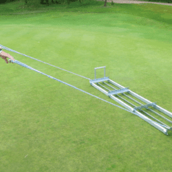 Image of Level Lawn Pull Behind Spreader - 72 in. being pulled on green turf